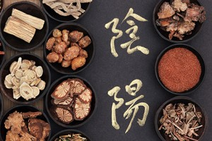 Chinese herbal medicine with yin and yang caligraphy script.